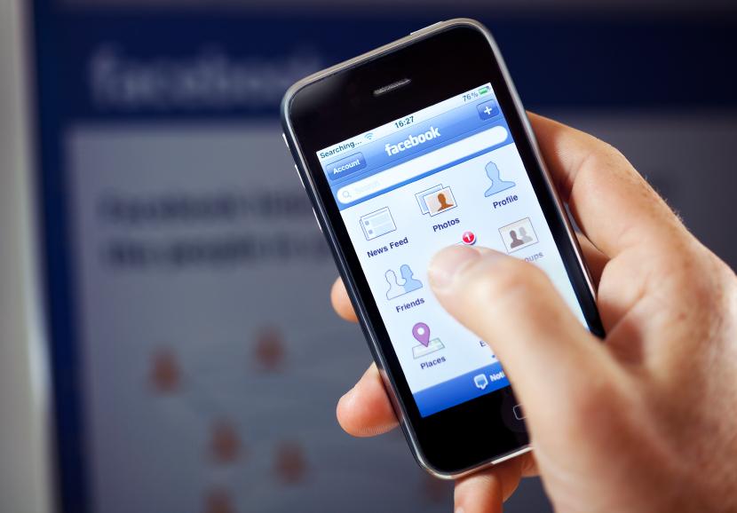 Facebook app in front of Facebook